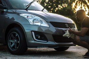 A man washes his car.