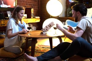 A couple playing Jenga together.